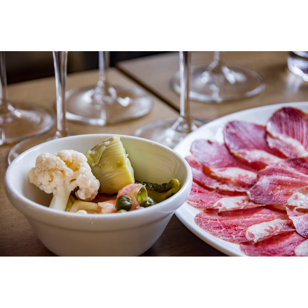 A platter of Iberian ham and pickled veggies